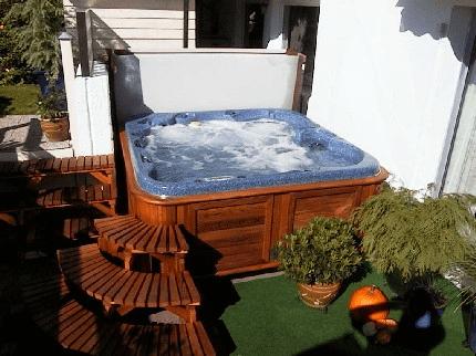 arctic spas hot tub tucked in corner