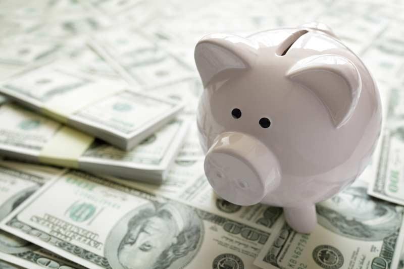 piggy bank on money 800x533 1