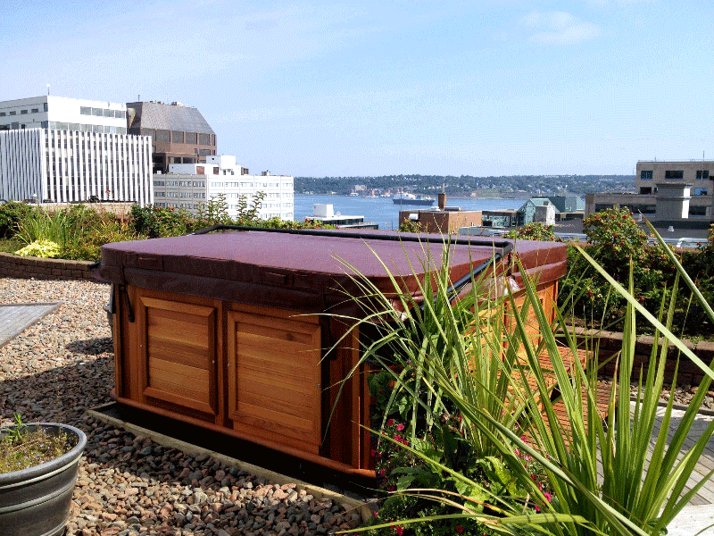 Covered Arctic Spas hot tub in the backyard overlooks a city